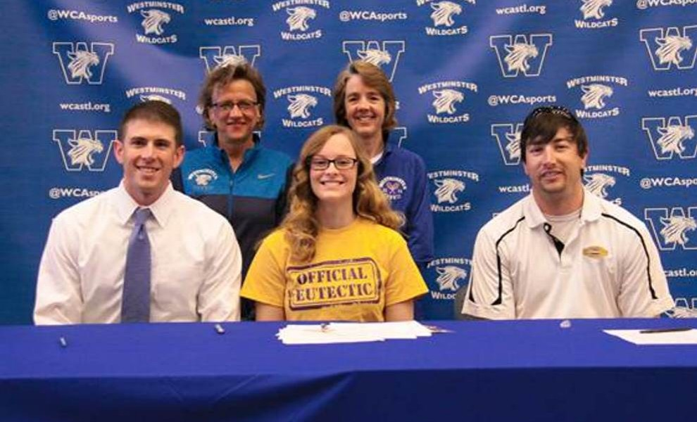 Emily Stevenson, flanked by Westminster Academy coaches and STLCOP head coach Caleb Barnes.