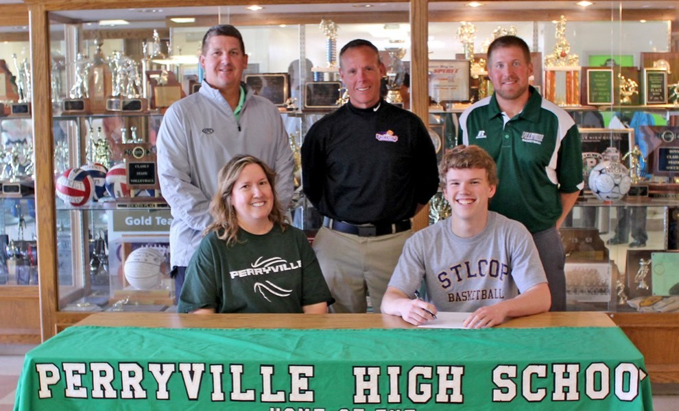 McGwire Bartley is flanked by his mother, Perryville AD and high school coach, and head STLCOP coach Brian Swift.