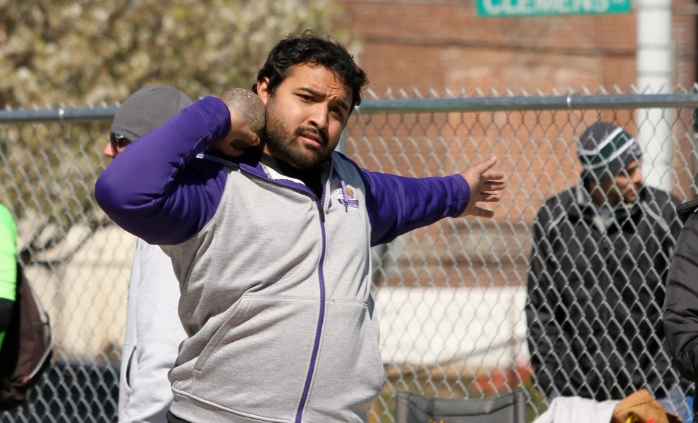 Kishan Patel warms up for the shot put. Photo by Kathy Arnold.