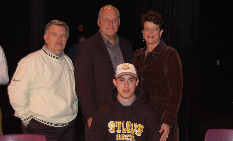 Luke Berra poses with his parents and head STLCOP soccer coach Jack Jamieson after signing a letter of intent.