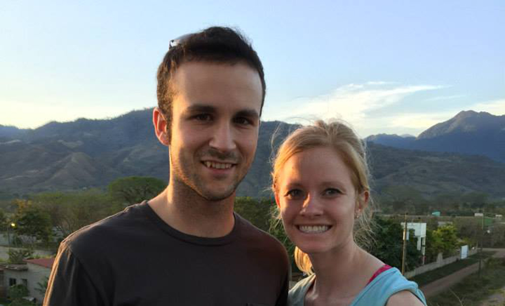 Matt McKenzie and Sarah Pollmann pose in front of mountains in Honduras.