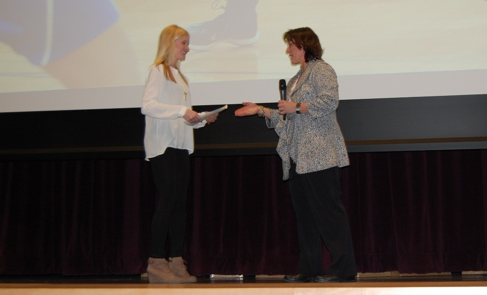 Sarah Pollmann accepts an award from Athletic Director Jill Harter at the 2015 STLCOP Athletic Awards Presentation on Jan. 17