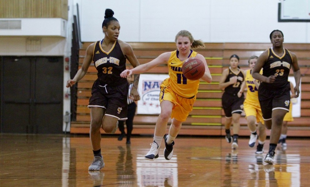 Allison Dewald drives down the floor with the Hornets in pursuit. Photo by Kathy Arnold.