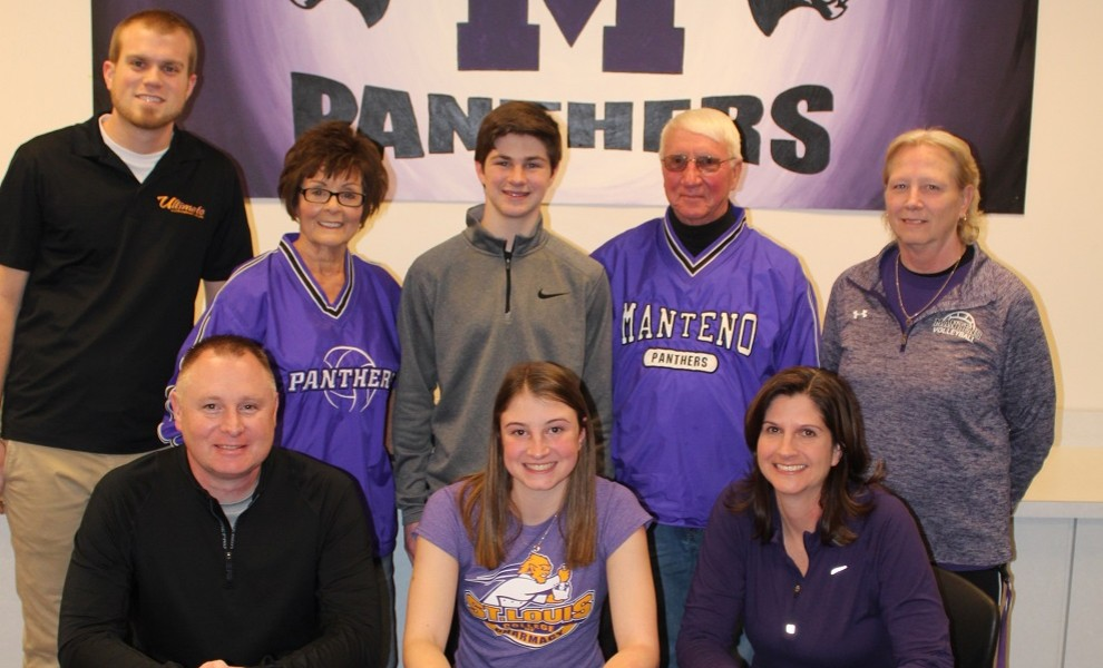 Aubree Mann, surrounded by family and coaches, signs a letter of intent to play volleyball at STLCOP.