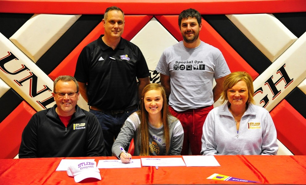 Cooper Fink is flanked by her parents, Tari and Jim Fink, with STLCOP coach Jamie Frisella and Union HS coach Matt Fennessey