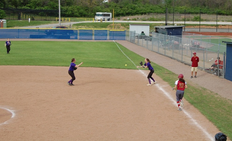 Tayler Evans tosses the ball to Jessica Kirk for a force at first against Park University.