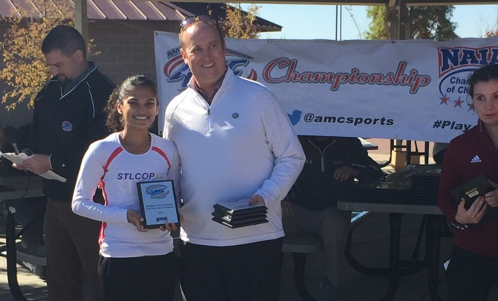 Janki Patel accepts her All-Conference plaque at the AMC Championships.