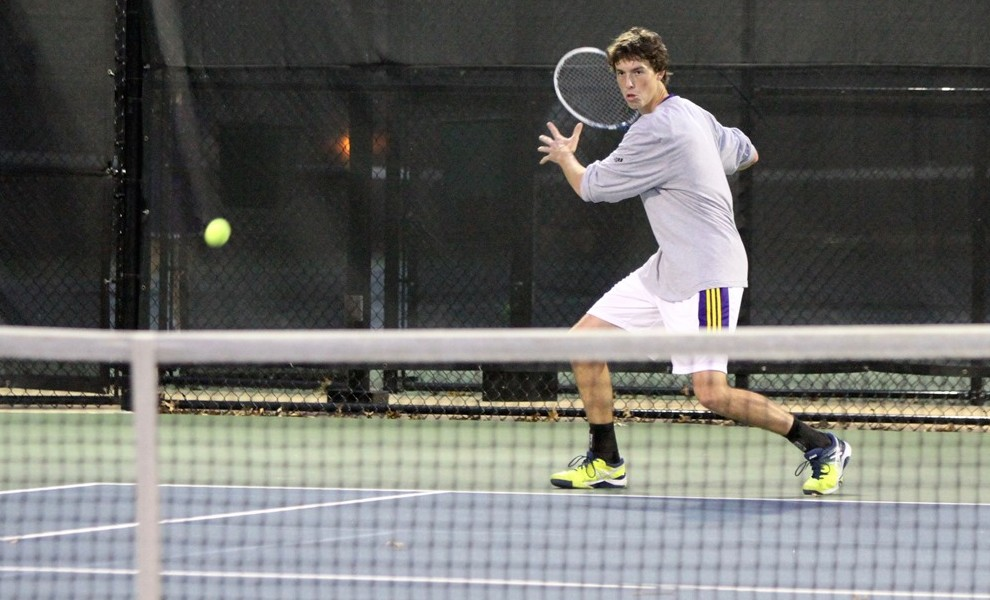 Logan Mathies won at court-one doubles and court-two singles. Photo by Kathy Arnold.