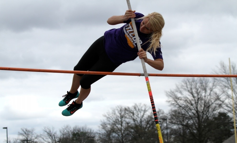 Katelyn Huhn, shown here competing outdoor last year, tied her own STLCOP record in the pole vault. Photo by Kathy Arnold.